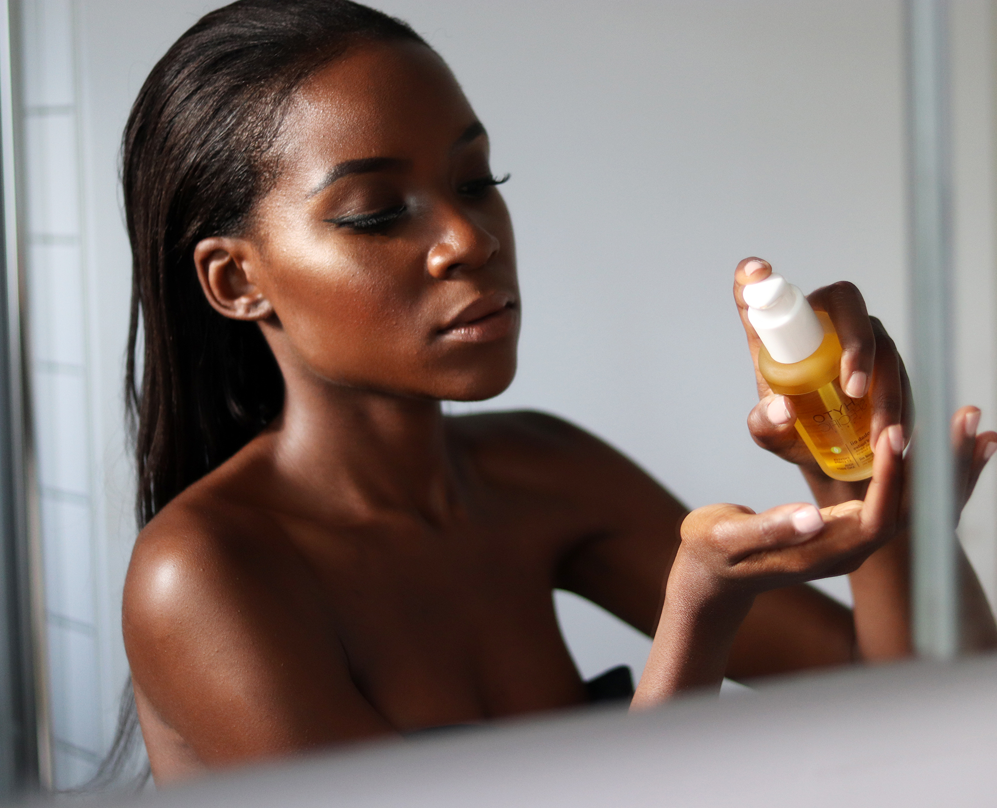 Using a nourishing hair oil by Phytp Specifics for relaxed hair.The oil contains a blend of oils which are great for repairing damaged relaxed hair.