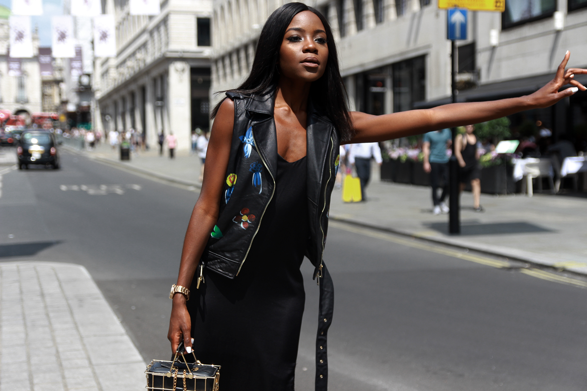 How to wear a sleeveless leather jacket in summer.